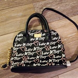Betsey Johnson satchel purse. New with tags.
